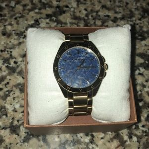 Blue Marble face Gold Coach watch